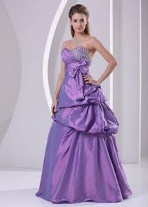 A-line Pick-ups Beaded Purple Dress for Graduation with Bow